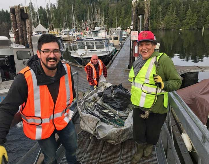 Salmon farmers cleaning up at an outdoor facility.