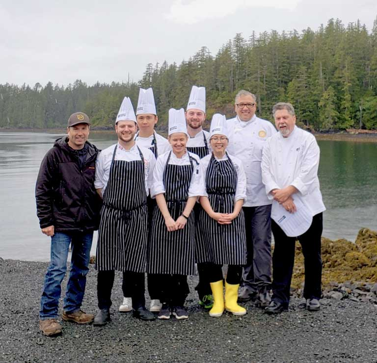 Members of BC Culinary team pose outside by ocean.